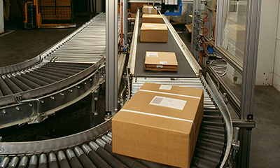 boxed packages on conveyor